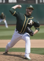 A's Shawn Kelley throws in relief