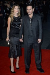 """Amber Heard and Johnny Depp attends a screening of """"Black Mass"""" in London"""