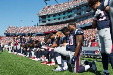 Patriots take nee during National Anthem
