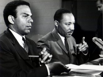 Dr. Martin Luther King, Jr. (R) president of the Southern Christian Leadership Conference, gestures