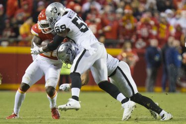 Chiefs Damien Williams is taken down by Raiders Tahir Whitehead and Erik Harris