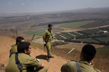 Israeli Soldiers Observe The Israeli-Syrian Border In Golan Heights
