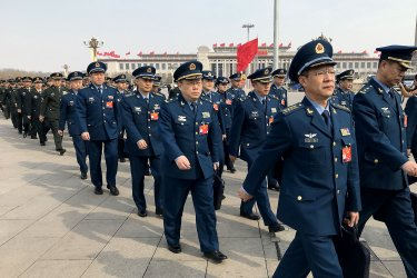 Chinese military delegates arrive for the NPC in Beijing, China