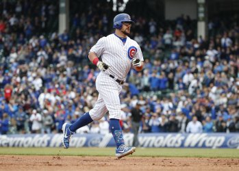 Chicago Cubs' Kyle Schwarber rounds the bases at Wrigley Field in Chicago