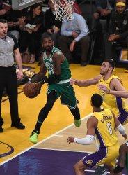 Celtics Kyrie Irving passes the ball by Lakers Jordan Clarkson at Staples Center