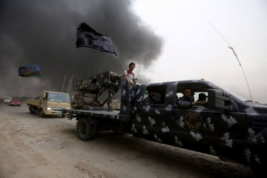 Iraqi Civilians Flee From Fighting in Mosul