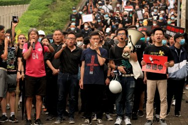 Protesters march to the government's offices in Hong Kong