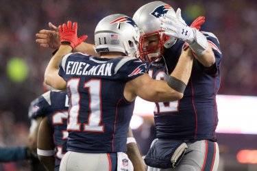 Patriots Edelman and Brady celebrate TD against Steelers in AFC Championship