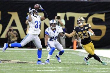 Lions safety Tavon Wilson intercepts a Drew Brees