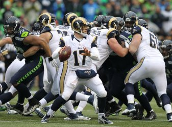 Rams Keenum looks to pass against the Seahawks