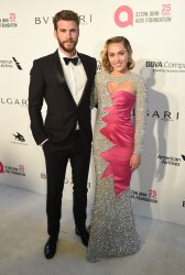Liam Hemsworth and Miley Cyrus attend the Elton John Aids Foundation Oscar viewing party in Los Angeles