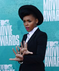 Singer Janelle Monae arrives at the 2012 MTV Movie Awards in Universal City, California