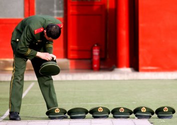 A police van sits outside the main entrance of the Forbidden City in Beijing