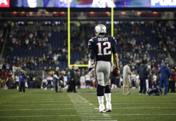 Patriots Brady warms up before game against Texans at Gillette Stadium in Foxborough, MA