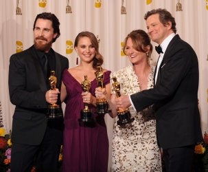 Best Supporting Actor Christian Bale, Best Actress Natalie Portman, Best Supporting Actress Melissa Leo and Best Actor Colin Firth pose backstage at the 83rd annual Academy Awards in Hollywood