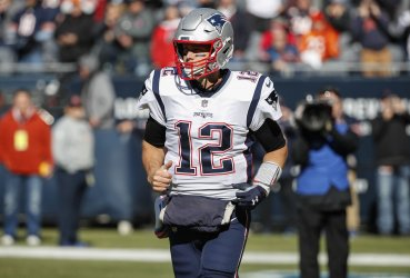 Patriots quarterback Tom Brady arrivew on the field before an NFL game against the Bears in Chicago
