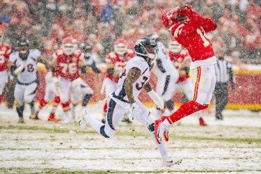 Chiefs' Sammy Watkins makes a catch downfield past Broncos Will Parks