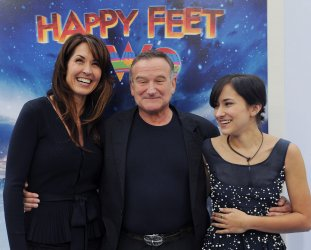 """Robin Williams attends the """"Happy Feet Two"""" premiere with wife and daughter in Los Angeles"""