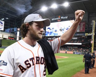 Astros Cole salutes fans after winning in ALDS game five in Houston