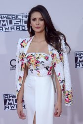 Nina Dobrev attends the 43rd annual American Music Awards in Los Angeles
