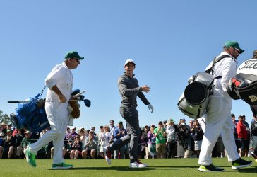 Rory McIllroy of Northern Ireland walks at the Masters