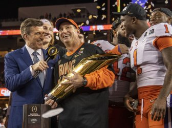 Clemson Tigers head coach Dabo Swinney holds Dr. Pepper National College Championship Trophy