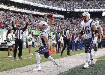 New England Patriots Julian Edelman spikes the football