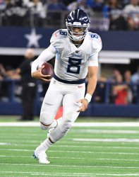 Tennessee Titans quartertback Marcus Mariota scrambles against the Dallas Cowboys