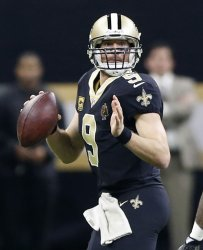 Saints quarterback Drew Brees throws against the Panthers in the Wild Card Playoff Game