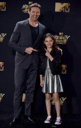 Hugh Jackman and Dafne Keen win award at the 2017 MTV Movie & TV Awards in Los Angeles