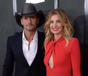 Tim McGraw and Faith Hill arrive for the 59th annual Grammy Awards in Los Angeles
