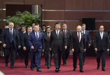 Xi escorts leaders to the opening ceremony of the BRF in Beijing, China