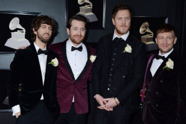 Ben McKee, Daniel Platzman, Dan Reynolds, and Wayne Sermon of Imagine Dragons arrive at the 60th Annual Grammy Awards in New York