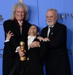 Brian May, Rami Malek and Roger Taylor backstage at Golden Globes