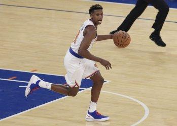 New York Knicks Frank Ntilikina brings the ball up court
