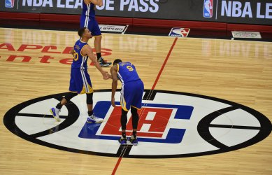Warriors Stephen Curry is bowed to by teammate Andre Iguodala