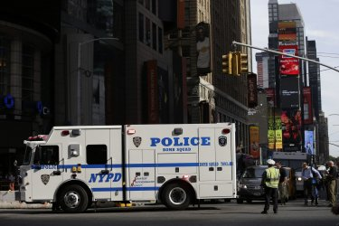 An NYPD bomb squad truck moves in Times Square