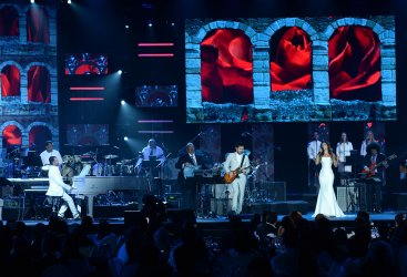 Singers Mario Domm, Pablo Hurtado of Camila, Paula Fernandes perform onstage at Person of the Year tribute in Las Vegas
