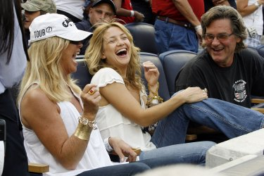Kate Hudson, Kurt Russell and Goldie Hawn watch the Boston Red Sox play the New York Yankees at Yankee Stadium in New York