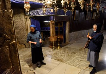 Nuns Visit The Grotto In The Church of Nativity On Christmas Eve