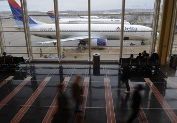Travelers pass through Reagan National Airport