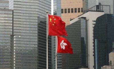 China and Hong Kong flags fly over Hong Kong