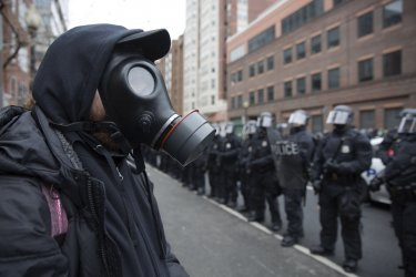 Protester wears gas mask during Trump's Inauguration in Washington, D.C.