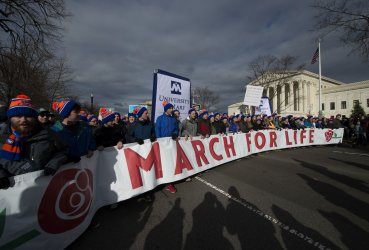 Participants carry a sign in the March For Life march .