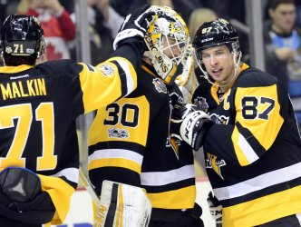 Pens Malkin and Crosby Celebrate 4-0 win with Goalie Matt Murray
