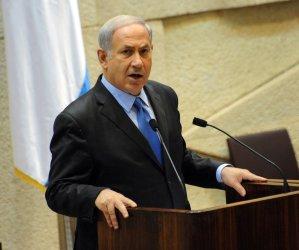 Israeli Prime Minister Benjamin Netanyahu speaks at a memorial session for slain Israeli Prime Minister Yitzhak Rabin in the Knesset in Jerusalem