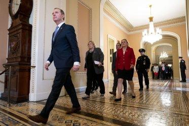 Senate Majority Leader McConnell walks to President Trump's Impeachment Vote