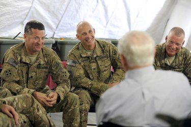 Defense Secretary Gates visits with troops on his farewell tour
