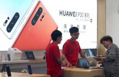 Chinese customers shop at a Huawei showroom in Beijing, China