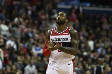 Washington Wizards guard John Wall claps after a big play